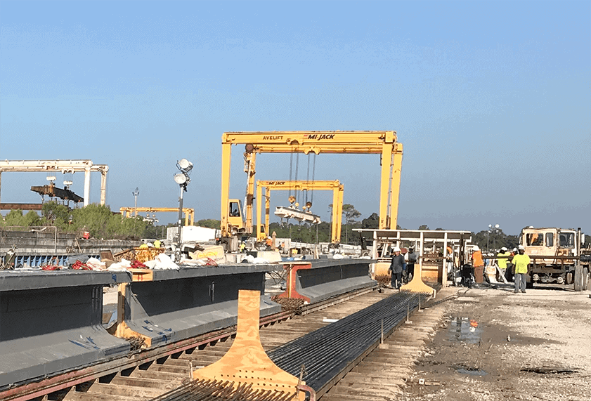 Cor-Tuf UHPC Girder product being lifted