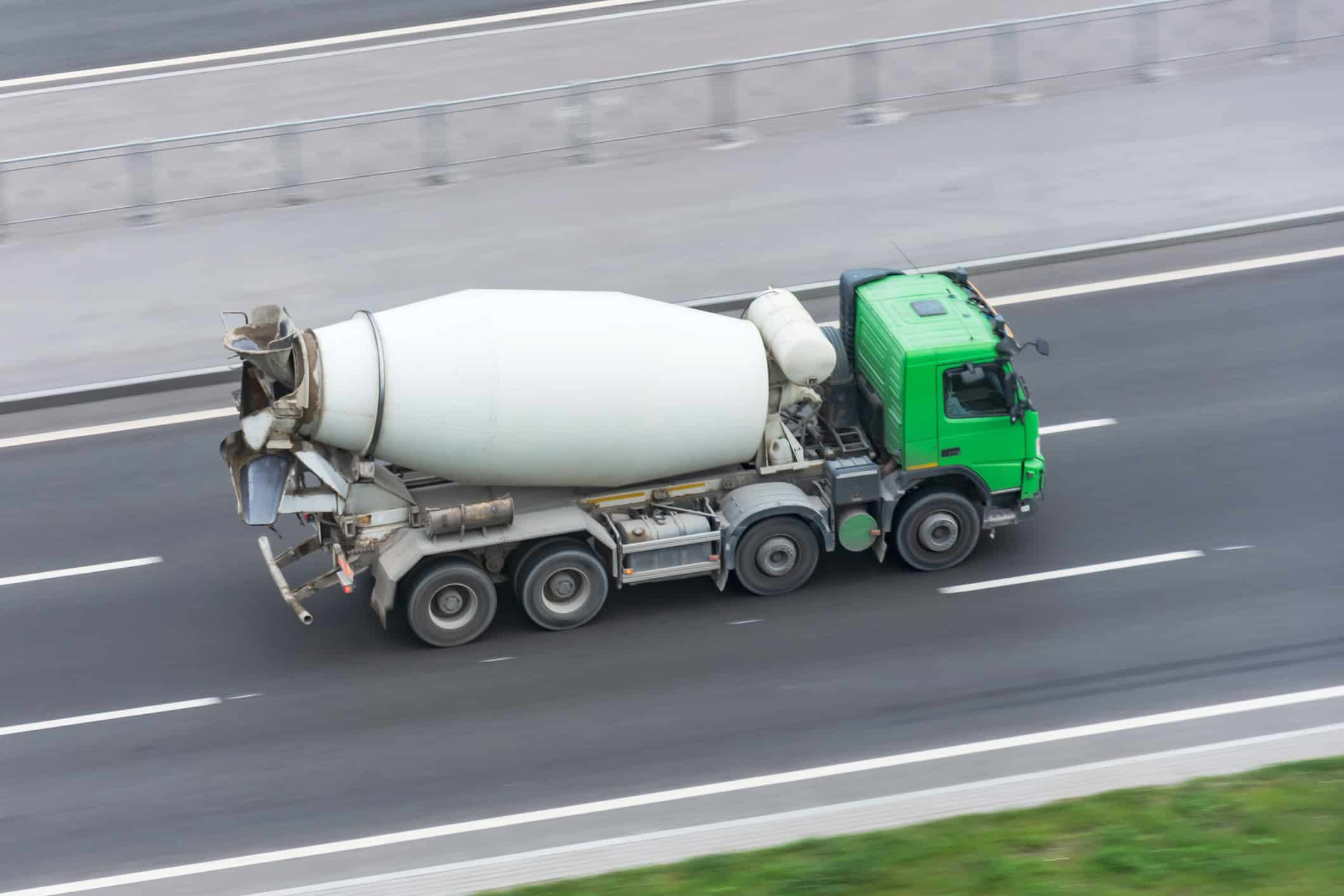 cement truck driving down the freeway