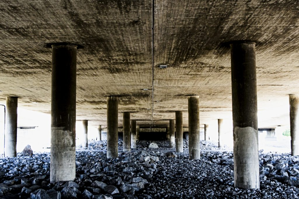 Deep and rough perspective from under a concrete bridge