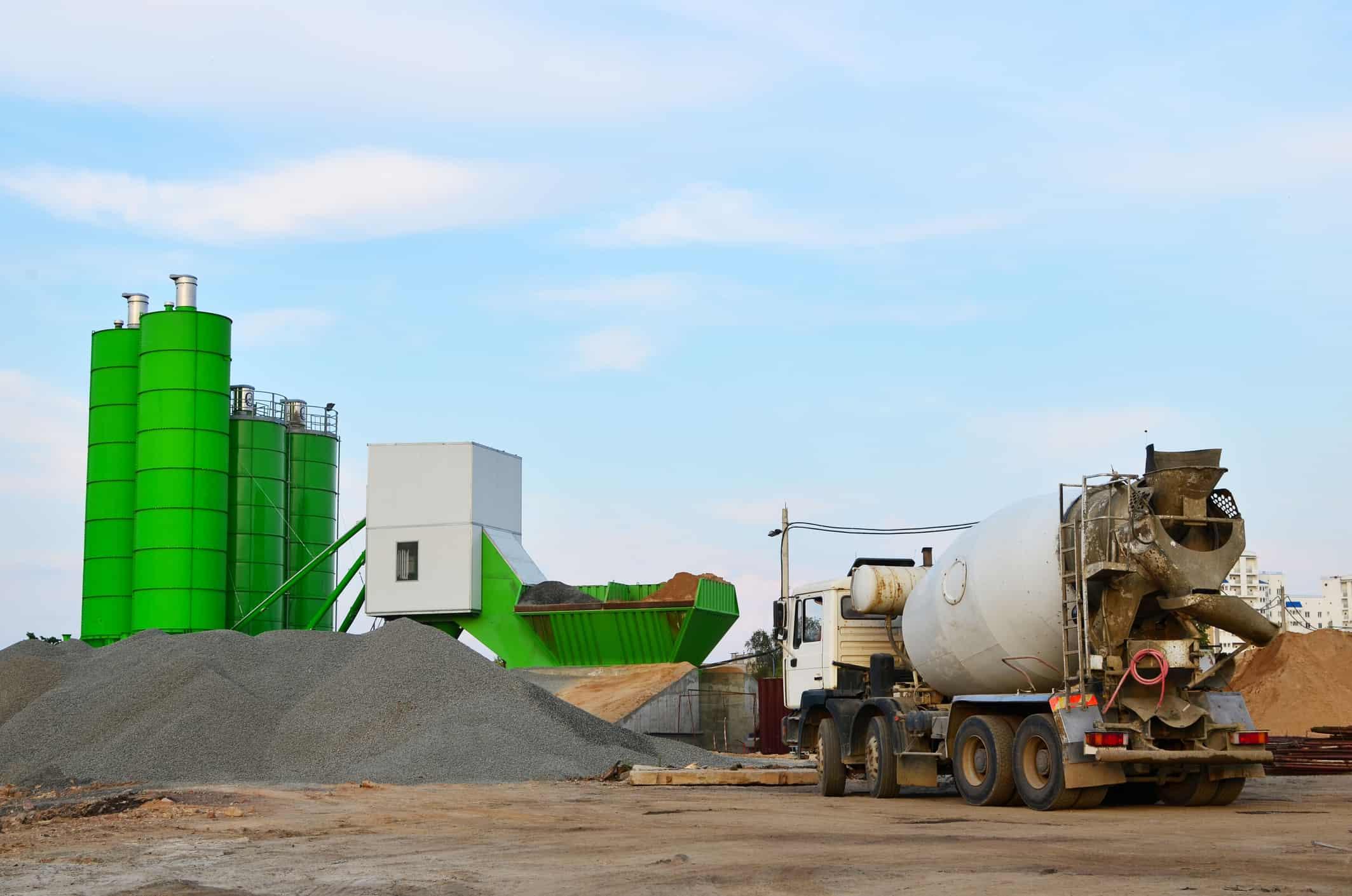 Concrete batching plant. Industrial producing concrete for construction. Heavy mixer concrete trucks